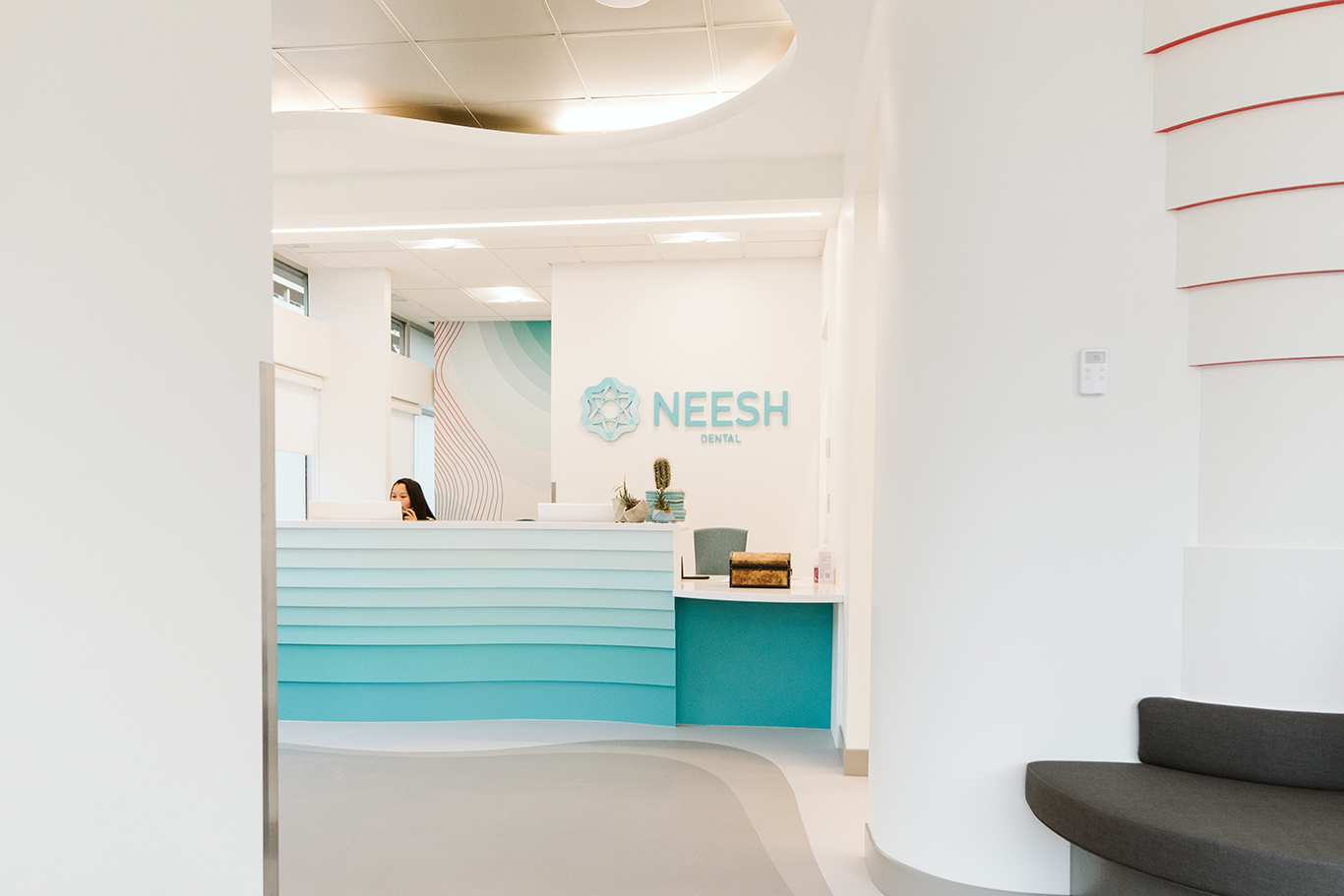 The reception desk of Neesh Dental in Saskatoon Saskatchewan