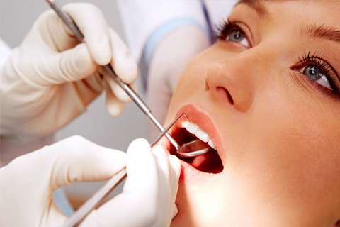Woman gets dental restoration at Neesh Dental in Saskatoon Saskatchewan